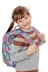 Happy joyful girl schoolgirl with satchel behind