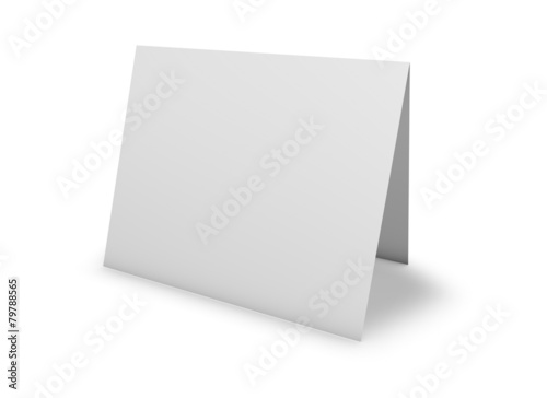 Leinwandbild Motiv Blank greeting card standing on floor, isolated on white.