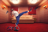 Fototapety Adult man dancing withvacuum cleaner