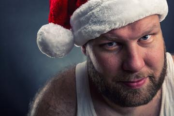 Smiling man in Santa Claus hat
