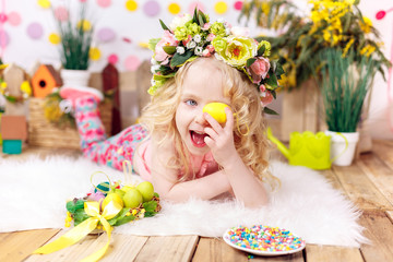happy little girl with easter eggs, smiling, easter decor