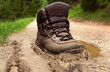 Tracking boot in a dirt - 79789532