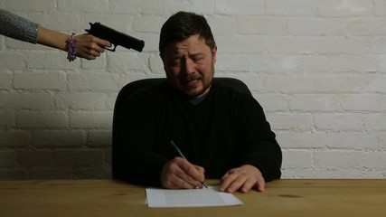 man siging contract at womans gun point under threat