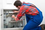 Technician servicing the underfloor heating - 79790340