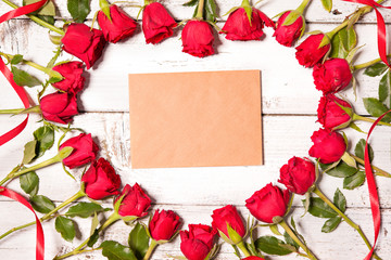 Roses arranged on old wooden background