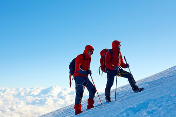 climbers at the top of a pass