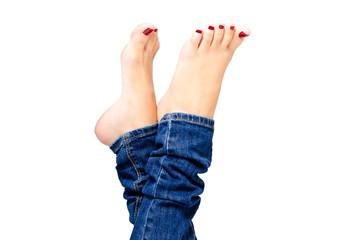 Female groomed feet in jeans closeup