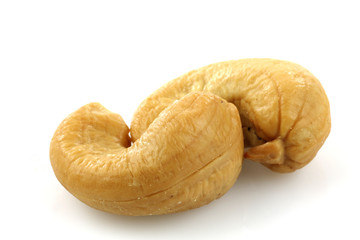 two cashew nuts on a white background
