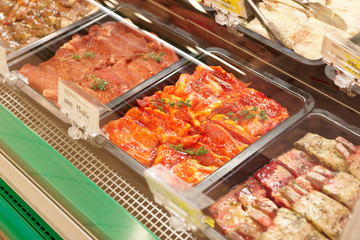 Meats in marinade on supermakket display