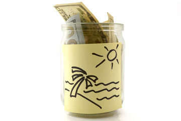 jar of money for traveling over white background.