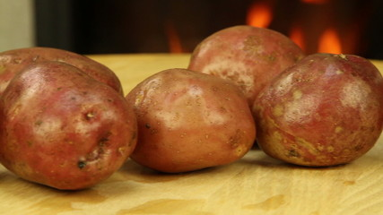 Pink unpeeled potatoes