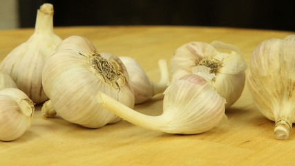 Garlic on a wooden boards background