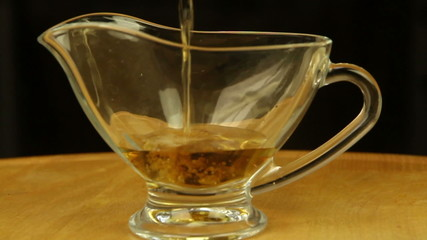 Vinegar is poured into a gravy boat