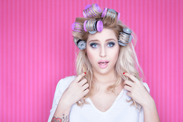 Young attractive woman with hair curlers