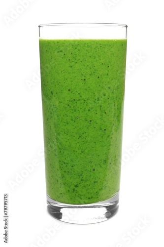 Green smoothie in a glass isolated on a white background
