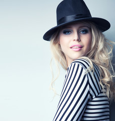 Young attractive blonde woman wearing hat