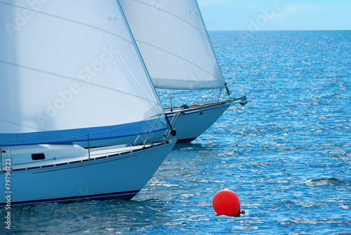 Foto op Canvas Zeilen Sailboats rounding a buoy in a race regatta