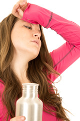 Stressed female model holding a stainless steel water bottle