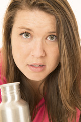 Close-up of a female model with a metal water bottle