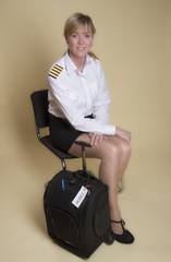 Attractive female airline pilot waiting to go on shift
