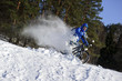 Cyclist riding mountain bike in beautiful snow winter forest
