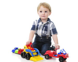 Toddler Playing Cars and Trucks