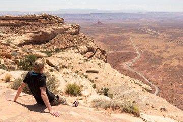 Young man enjoying the view on the deserts of monument valley