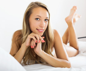 woman posing on bed
