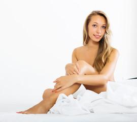 beautiful nude girl sitting on bed