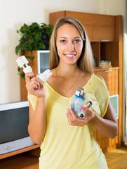 Housewife holding light bulbs