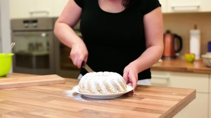 Female baker preparing a marble cake to be served