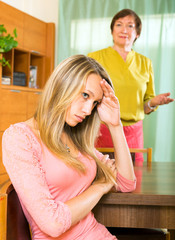 Sad  daughter against mature mother