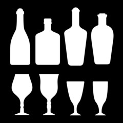 set white alcohol bottles and glass