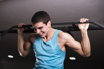 Young man lifting himself