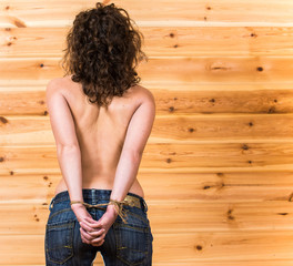 Graceful topless young woman with bounded hands from behind