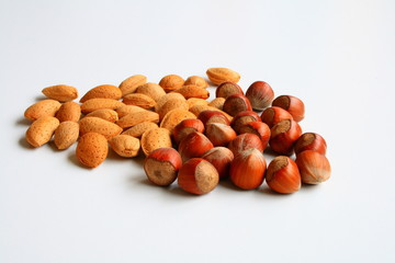 Almonds and hazelnuts isolated on white background