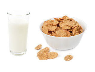 Cornflake cereals in bowl and glass of milk