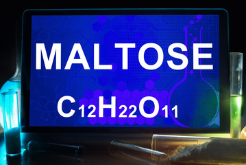 Tablet with chemical formula of  maltose.
