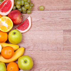 Fruits and vegetables on a wooden background