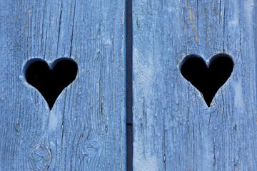 Blue wooden window shutters in France