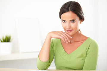 Latin girl looking smart in her green shirt