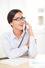 Latin company secretary conversing on the phone