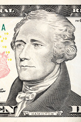 Alexander Hamilton portrait from ten dollar bill close-up.