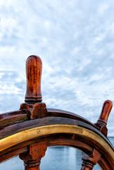 Old ship wheel close up. Leadership, direction, navigating