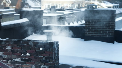 chimney blowing smoke in the winter