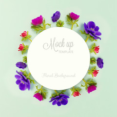 Floral background. Anemone flowers and round paper