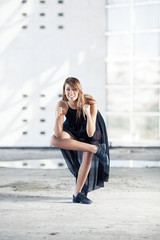 Young woman performing modern dance pose