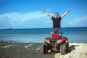 Happy ATV driver on the beach