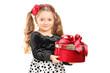 Cute little girl holding a present