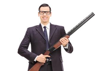 Male bodyguard holding a shotgun